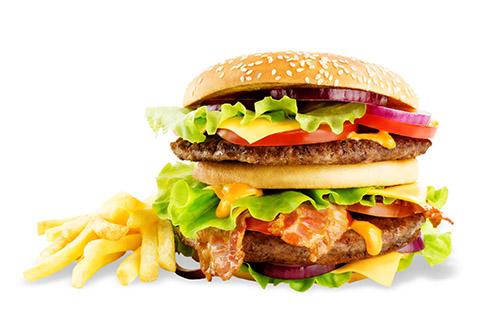 Meat Burger with salad, cheese, tomato and cheese sauce isolated. toning